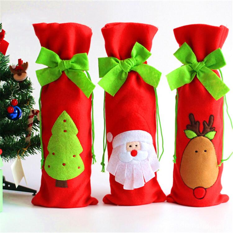 Сумочки для шампанского из фетра с новогодними рисунками помогут сделать праздник ярким и оригинальным